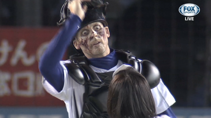 FIC Japan's Zombie first pitch where the catcher took off his mask (photo credit to FIC Japan)