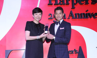 Josephine Chan Managing Director of SCMP Hearst Publications presenting Most Iconic Man of Asia to Aaron Kwok