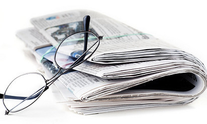 Newspaper and Reading Glasses