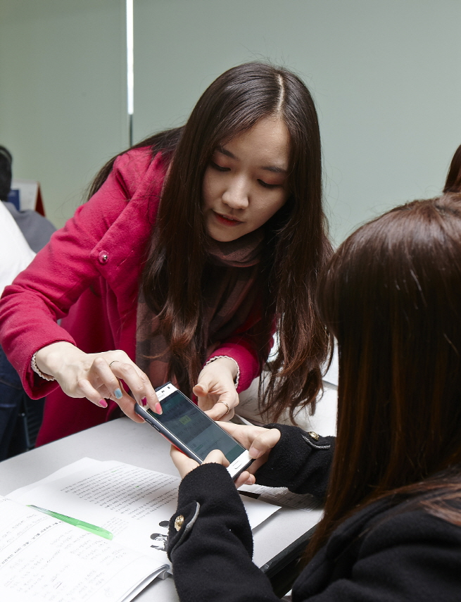A Cheil employee teaching students at the Yeomyung School, South Korea's first accredited alternative school for North Korean defectors.