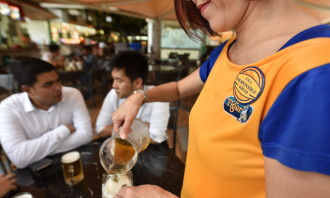 Image 1 - ASSET-trained beer promoters identified by 'I'm a Responsible Server' badges