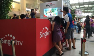 Crowd watching the AR execution from Singtel, in partnership with Mediacorp OOH Media