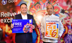 Forging the partnership between Globe Telecom and the Tourism Promotions Board to offer the Globe Traveler SIM for free to tourists and balikbayans are Globe SVP Nikko Acosta and TPB COO Domingo Enerio III(1)