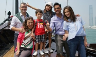 Actor and pilot Michael Wong, his wife Janet Ma together with a real family cast.