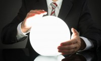 44304428 - close-up of businessman predicting future with crystal ball at desk