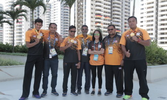 Fara Hasan with coaches and athletes