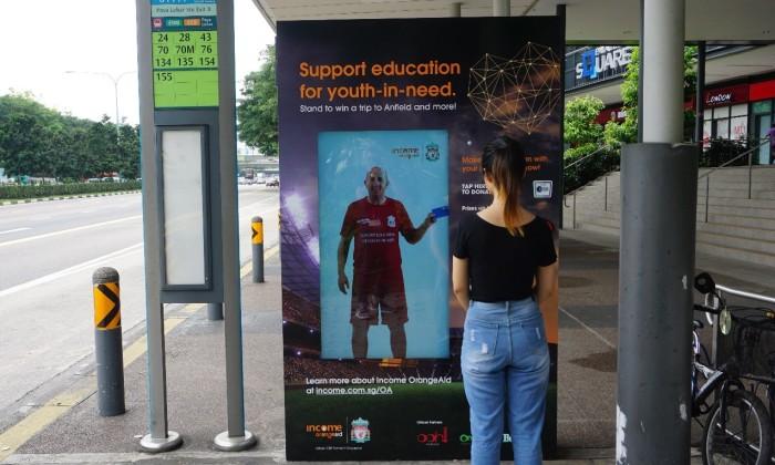 The interactive donation kiosk at Paya Lebar Square