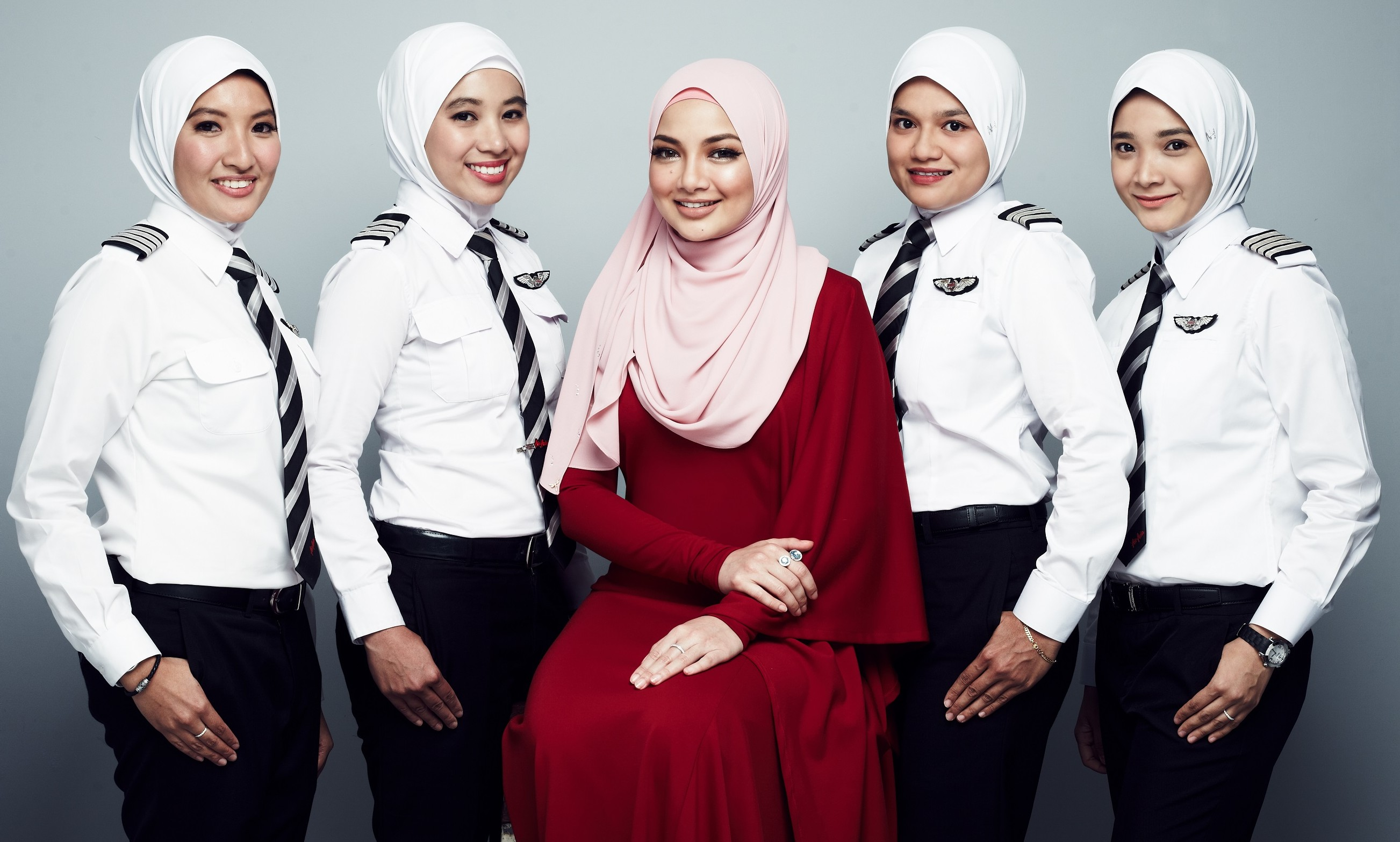 AirAsia partners hijab brand from Malaysian famous hijab icon, Neelofa (in red) to create exclusive headscarf for female pilots | Marketing Interactive