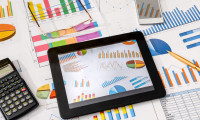 business workplace with tablet, smartphone and charts and graphs, pen
