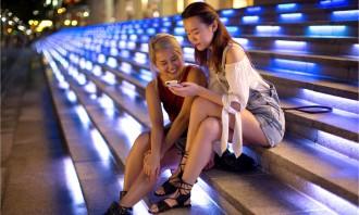 Spotify girls looking at phone