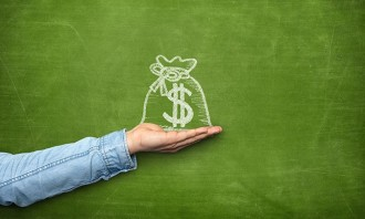 Money bag icon on blackboard with hand