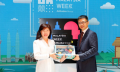 Dato' Ng Wan Peng, chief operating officer, MDEC (left)  was presented with a limited edition Tmall dolls by Jet Jing, president of Tmall (right) at the launch of Malaysia Week in Hangzhou, China.